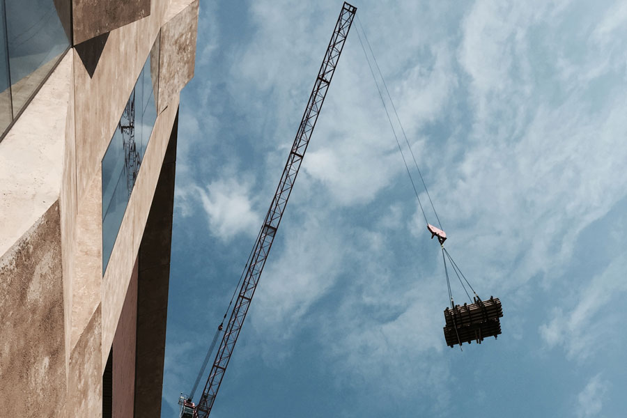 A construction crane at the Mint Residential site in Uptown Charlotte