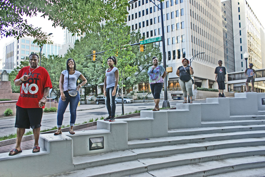 a family pose for a photo in Uptown Charlotte