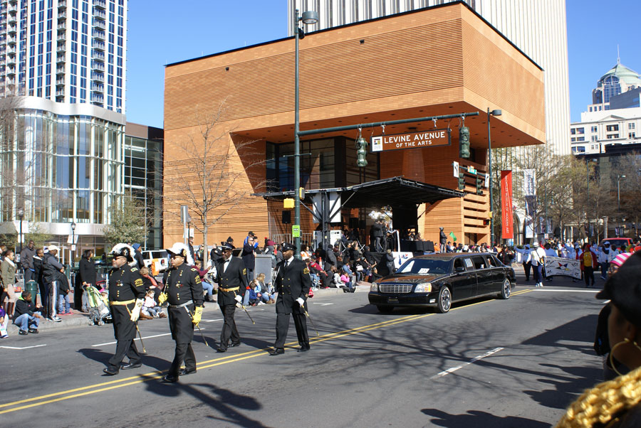 The MLK parade in Uptown Charlotte with the modern art museum in the background.