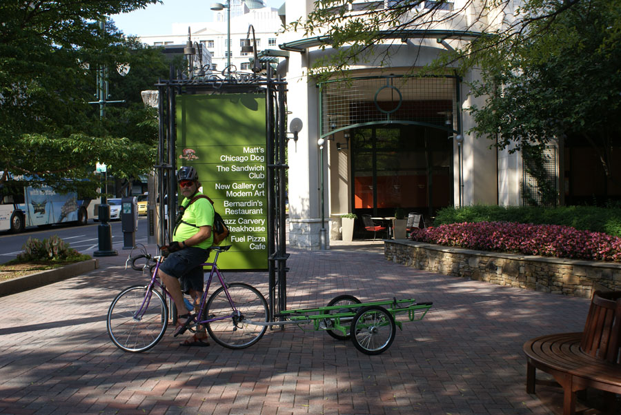 B-cycle green guy shuttles bicycles between stations in Uptown Charlotte