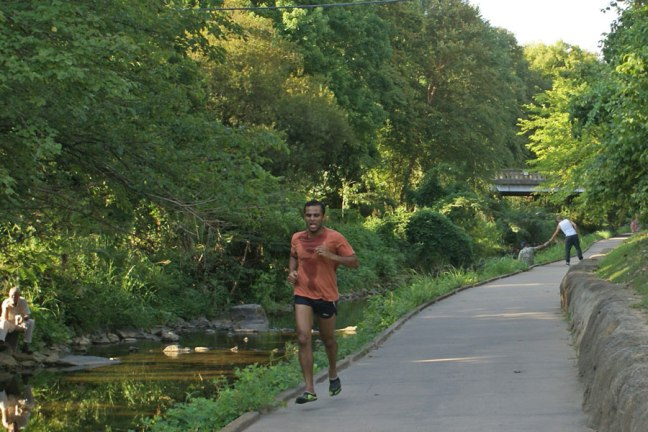 Jogger on the Little Sugar Creek greeway near Uptown Charlotte.