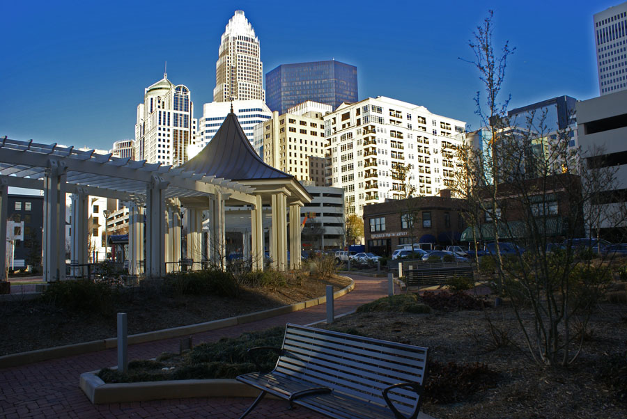 The Charlotte skyline lit in bright sunlight.