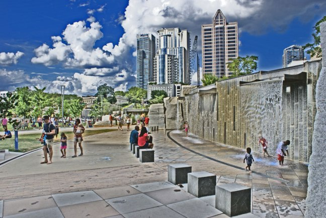 Playing in the water wall at Romare Bearden Park in Uptown Charlotte