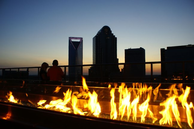 The fire pit at Fahrenheit rooftop lounge in Uptown Charlotte
